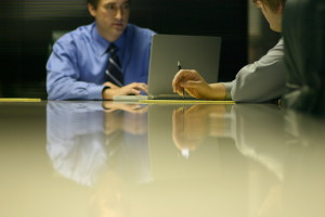 two men at conf room iStock_000000247632Small[1]